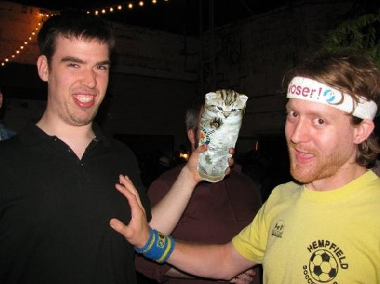 why is everbody groping boobs today? and does his sweatband say loser? it's no wonder this poor boozecat is hiding so deep in his pint glass shell